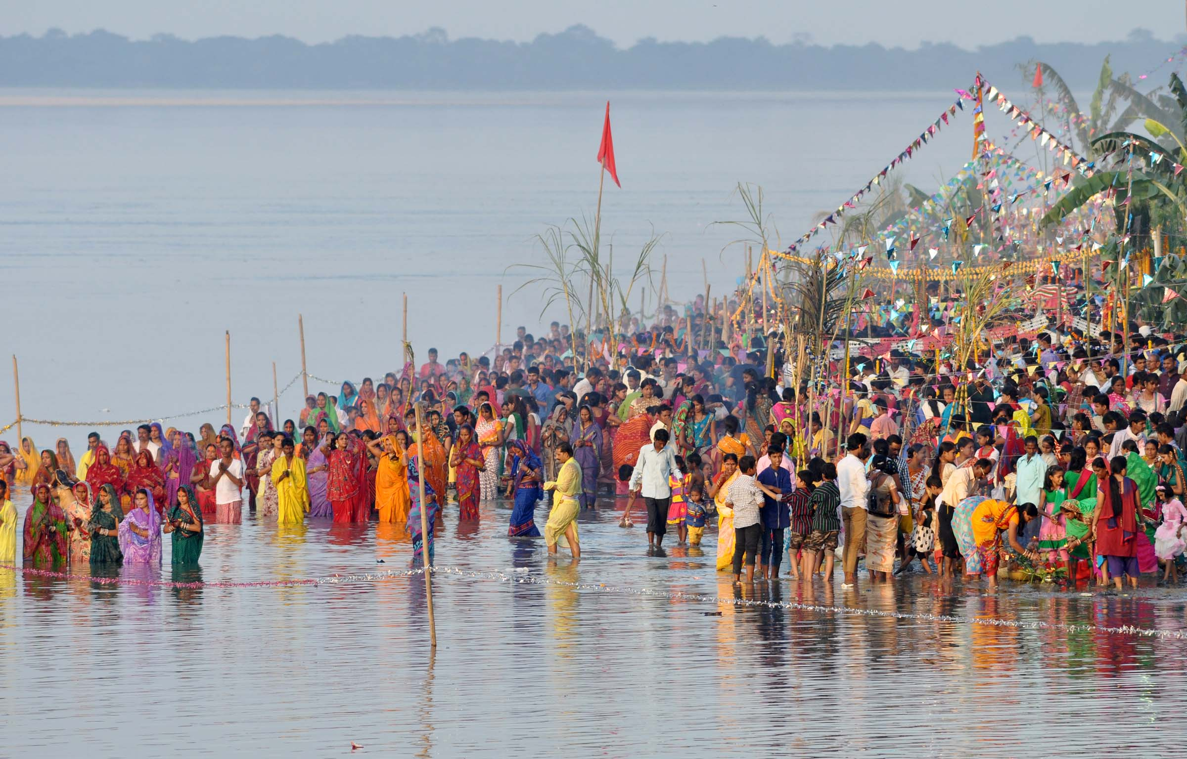 Hindu devotees performed rituals during Chhath Puja while standing in the river Brahmaputra in Guwahati on Wednesday October 29, 2014 . Devotees pay obeisance to both the rising and the setting sun during the Chhath festival. Photo- Reba Kumar Borah.