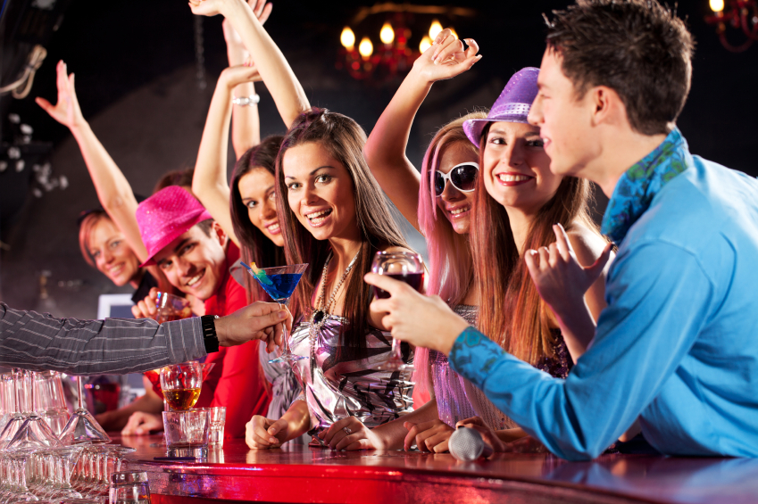 Large group of friends taking drinks at the bar counter. [url=http://www.istockphoto.com/search/lightbox/9786738][img]http://dl.dropbox.com/u/40117171/group.jpg[/img][/url]
