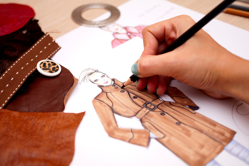 Fashion designer is drawing a fashion sketch for autumn-winter season