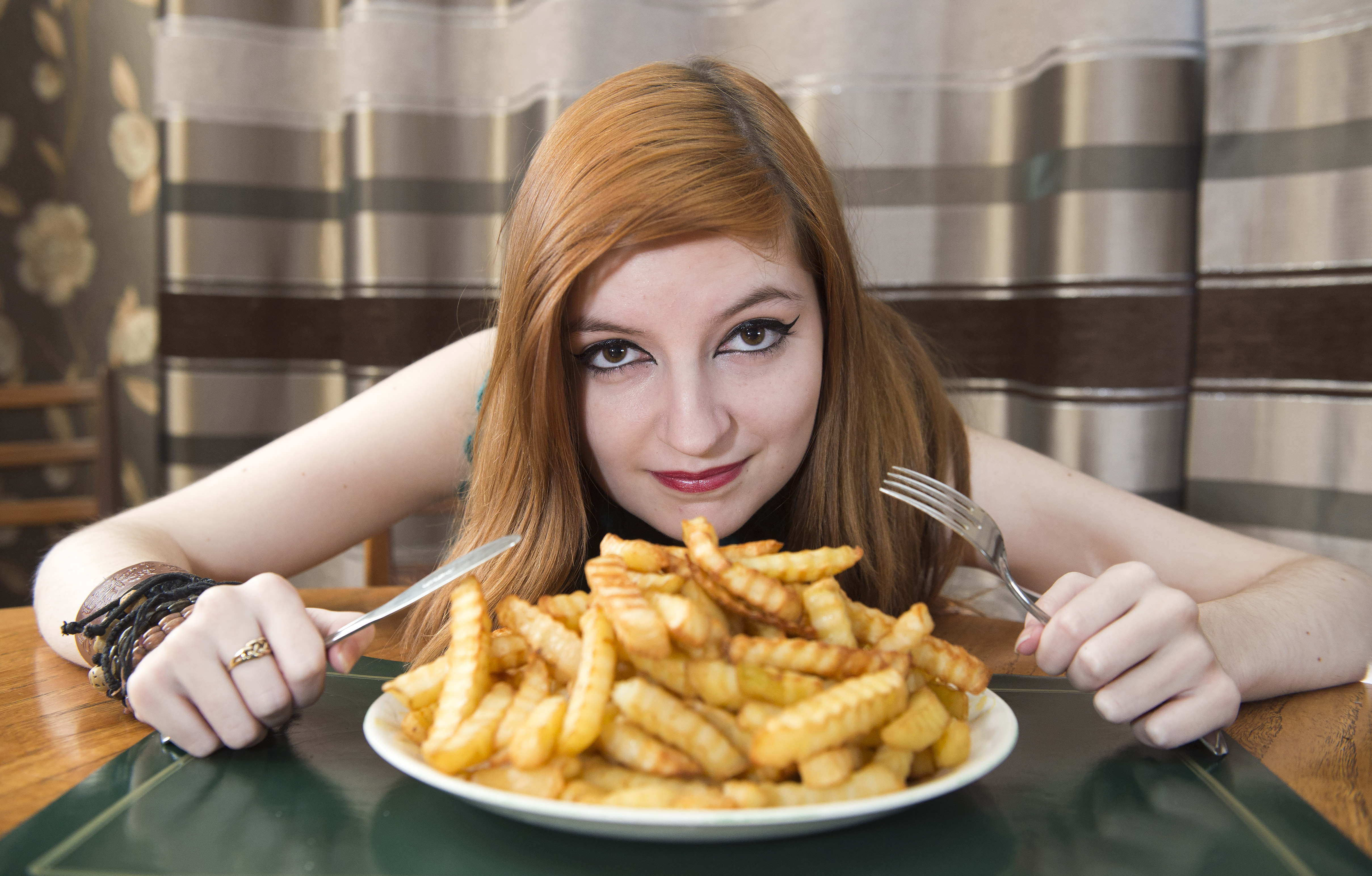 PIC FROM CATERS NEWS - (PICTURED: Jennifer Radigan with her chips ) - A pretty girl who suffers from a food phobia has lived off a diet of chips for five years because all other foods make her sick to the stomach. Jennifer Radigan, 17, eats mostly oven chips and is so repulsed by the thought of eating meat and vegetables, she often heaves at the sight of it. The teenager, from Galston, East Ayrshire in Scotland, is so fussy about what she eats; even the brands have to be right, with her typical daily diet consisting of a plate of McCain chips topped with cheddar cheese. A-level student Jennifer, who started refusing food from a very early age, says she used to be so ashamed of her phobia, she would starve herself at school, then later lie to her parents that she had eaten.