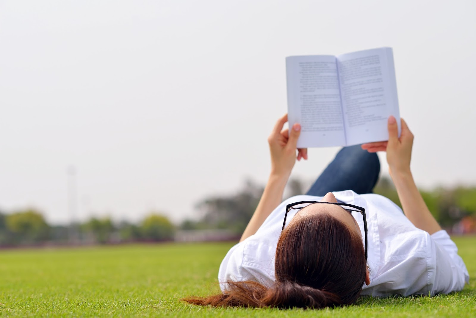 20826984 - young student woman reading a book and study in the park