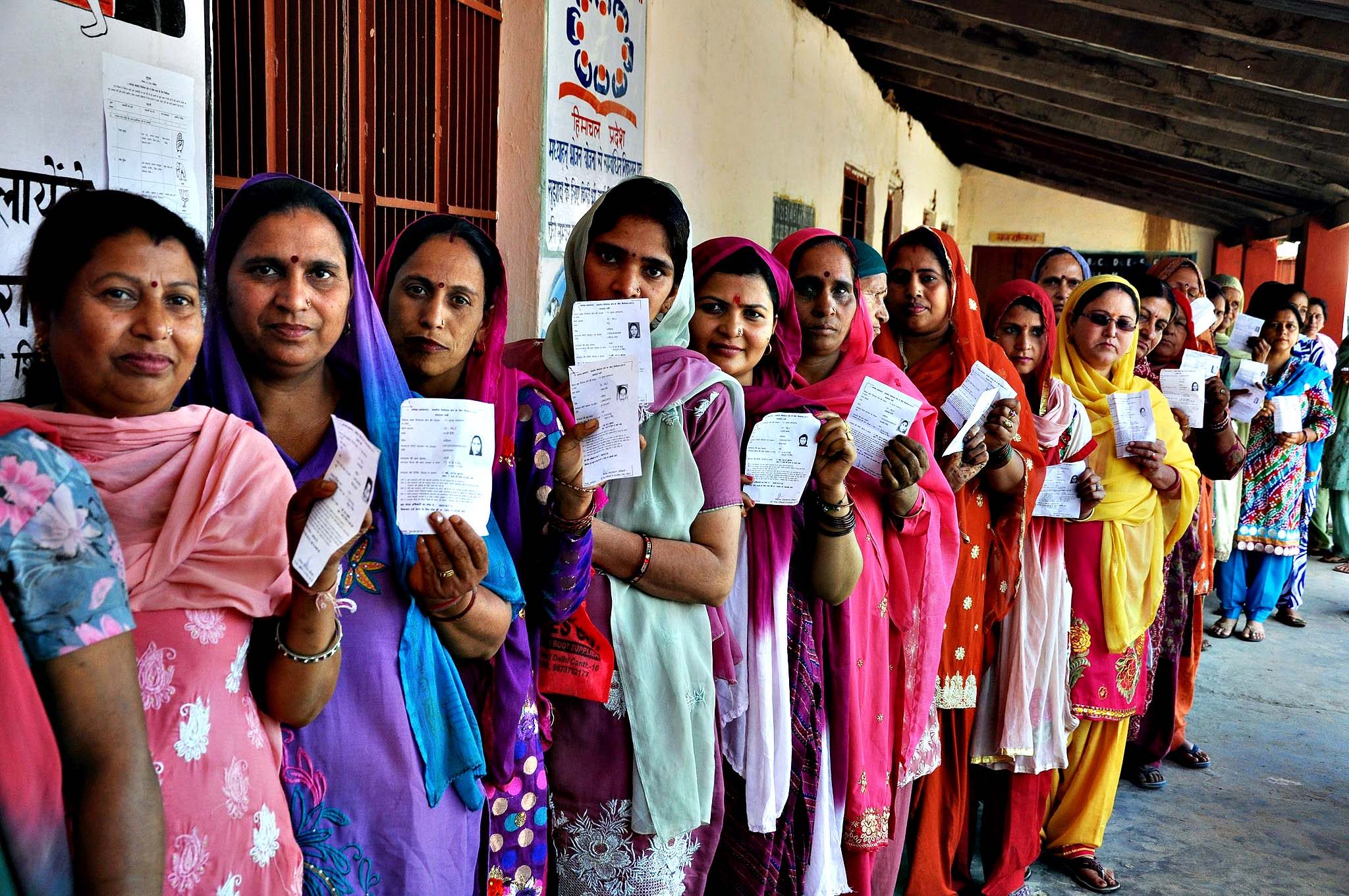 Voting during 8th phase of Parliamentary election...epa04194527 Indian women show their voting slips as they wait to cast their votes at a polling station during the 8th phase of Parliamentary election at Palampur, Himachal Pradesh, India, 07 May 2014. Parliamentary elections in India are being held in nine phases between 07 April and 12 May 2014. A total of 814.6 million people are eligible to vote, around 100 million more than in the elections in 2009. EPA/SANJAY BAID