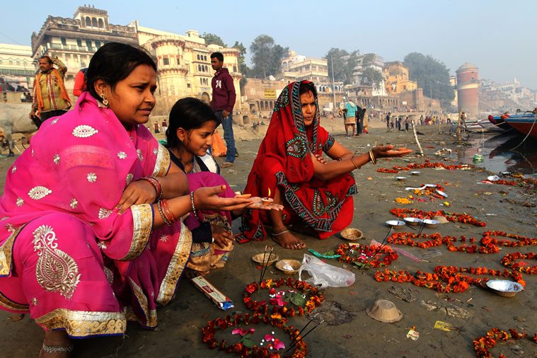 Devotee women perform Makar Sankranti Puja after taking a holy dip in Ganga river at the Assi Ghat in Varanasi on Thursday. Express Photo by Anand Singh. 14.01.2016.