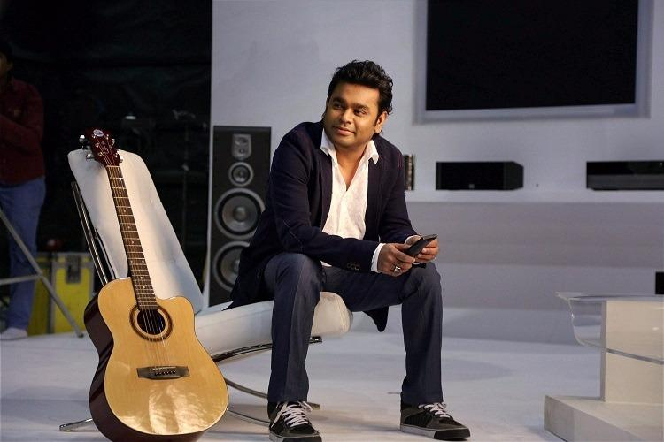 rahman with guitar-stayreading