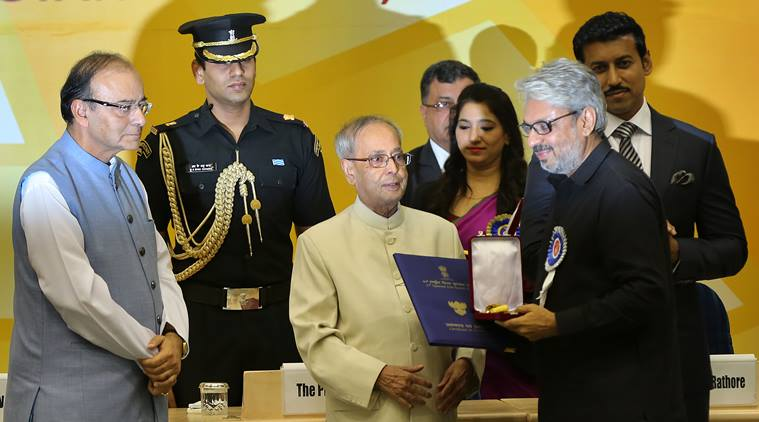 Filmmaker Sanjay Leela Bhansali receives the best direction award from President Pranab Mukherjee at the 63rd National Film Awards 2015 in New Delhi on May 3rd 2016. Express photo by Ravi Kanojia.