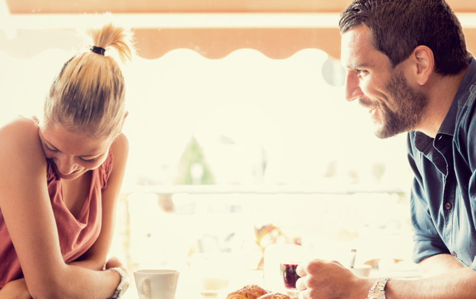 Young couple has breakfast at italian café