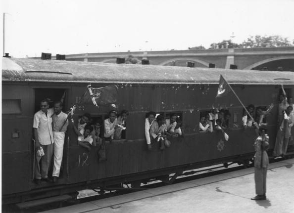 7th August 1947: One of 30 special trains leaving New Delhi Station which will take the staff of the Pakistan government to Karachi. Muslim League National Guards stand to attention in honour of the departure. 600 Delhi muslims were relocated to Pakistan following the partition. (Photo by Keystone Features/Getty Images)