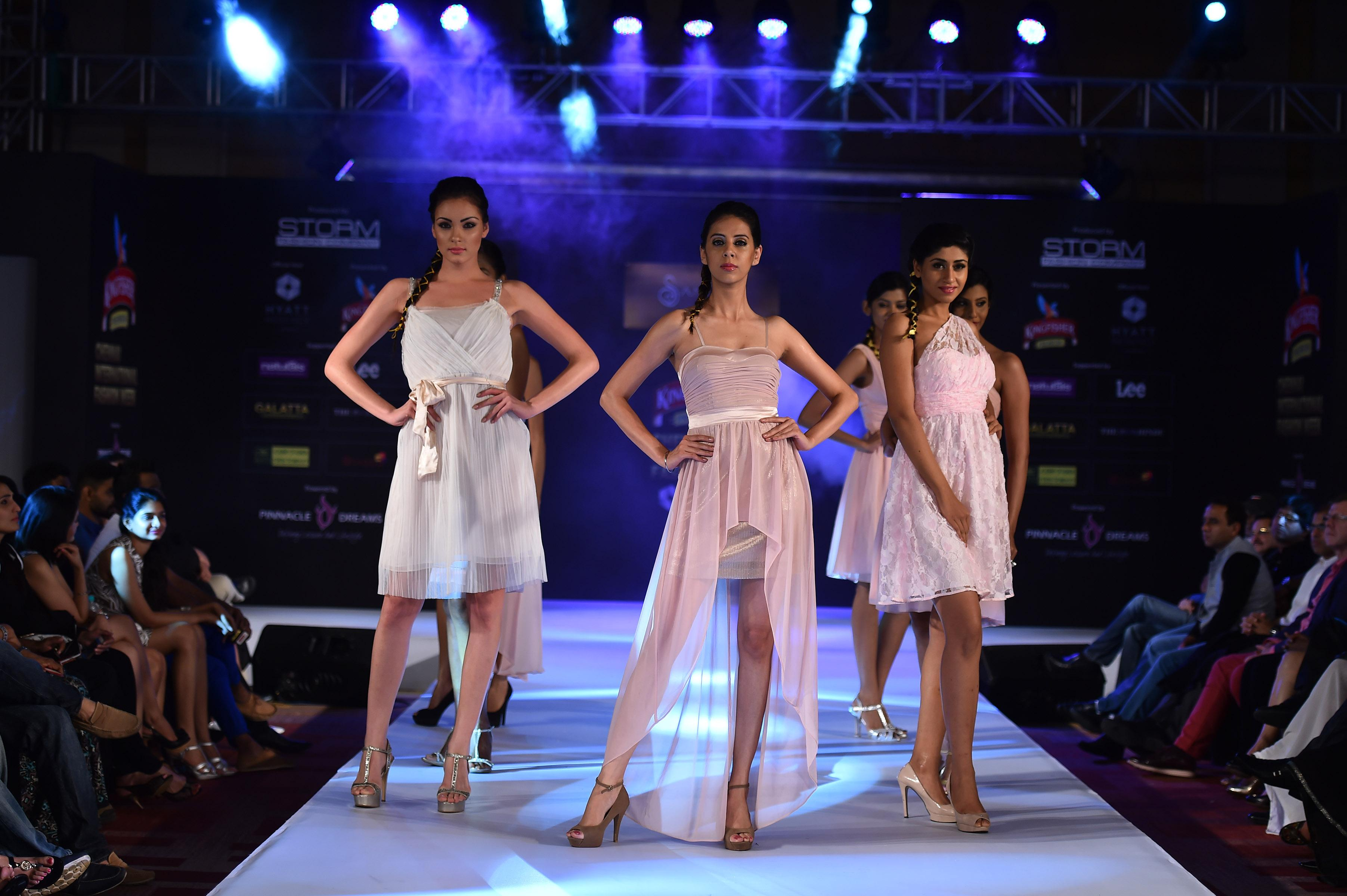 Models walk the ramp during the 6th edition of Kingfisher Premium Chennai International Fashion Week 2014 in Chennai on July 20, 2014. (Photo: IANS)